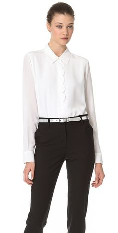 A timeless button-down blouse, made feminine with a scalloped placket. Equipment Brett Clean Scalloped Blouse