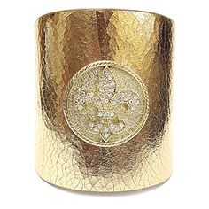"""This leather cuff is constructed of thick, resistant, genuine leather, has a snap closure feature, and is accented in a crystal-studded Fleur-de-lis matching the leather color. The cuff is adjustable for a desirable fit. Material: Genuine Leather - Size: 10"""" Long x 3"""" Wide - Color: Gold $39.99"""