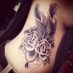 love this except upside down -- thefeathers on the bottom and the flowers on the top and on the side of my thigh :)