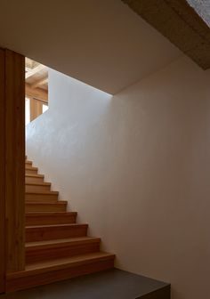 Rothaus | Jonathan Tuckey Design, Andermatt, Switzerland. A natural white plaster finish was applied to the walls. Larch timber joinery.