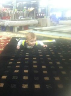 Junior's out buying his first rug!