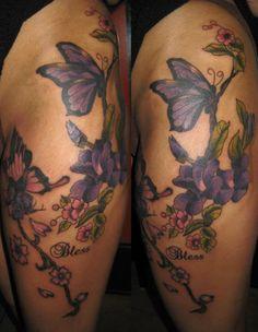 Flower butterfly tattoos purple flowers and butterfly thigh Butterfly With Flowers Tattoo, Butterfly Tattoo Cover Up, Butterfly Tattoo Meaning, Butterfly Tattoo On Shoulder, Butterfly Tattoos For Women, Butterfly Tattoo Designs, Butterflies, Tattoo Flowers, Tatoo
