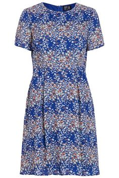 PST15 Poppy Lux Sybil Floral Fit and Flare Dress - Wrap yourself in falling Spring blossoms, perfect for lifting your spirits and setting you up for the move into warmer weather. The Sybil Dress features a delic...