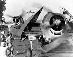 US Navy F6F Hellcat fighters of VF-10 'Grim Reapers' of Carrier Air Group 10 landed on carrier Enterprise after attack on Truk, 17-18 Feb 1944; note folded wings