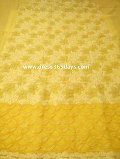 yellow embroidered fabric