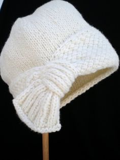 """This hat is made in two parts. I would say this would be challenging for a beginner or for an intermediate knitter. You should know how to pick-up stitches, knit in the round with circular and/or DNP and may need some minor re-calculations if you need a size out of the """"average""""."""