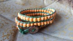 Green Leather and Orange Wooden Bead Triple by StudioSunshineCo