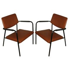 Pair of 1950's Arm Chairs | From a unique collection of antique and modern armchairs at http://www.1stdibs.com/furniture/seating/armchairs/