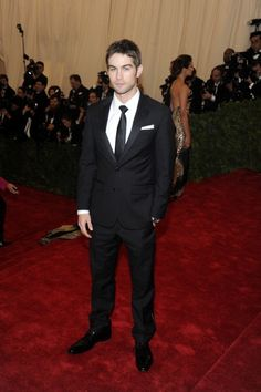 Chase Crawford plays it safe with a clean tuxedo on the red carpet of the MET Gala in NYC. See full gallery here: http://bit.ly/ISkhB2