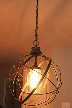 This is a very unique repurposed/upcycled decorative metal orb turned into a lovely, charming hanging pendant light/chandelier. The interior light