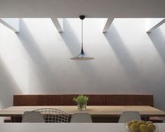 A rooflight washes a polished plaster wall and built in dining banquette with light Polished Plaster, Polished Concrete, Modern Family, Home And Family, Dublin House, Roof Light, Plaster Walls, Concrete Floors, Ground Floor