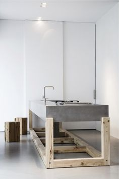 Me and JJ been wanting to build this concrete counter. Wood feature and #applebox stools / / Located at Weiss-Cucinebianchi Cucine Scultura in Italy / #bespoke kitchens and furniture / kitchen monolithic; conflating an indivisible and uniform shape signifying large and powerful.