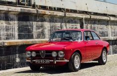 It's #FlashbackFriday and today we look back at the 70's. This 1970 Alfa Romeo 1750 GTV represents one of the simplest, yet most sensual cars ever designed.  #LaMeccanicaDelleEmozioni Alfa Romeo 1750, Back Friday, Looking Back, Cars, Design, Autos, Car, Automobile