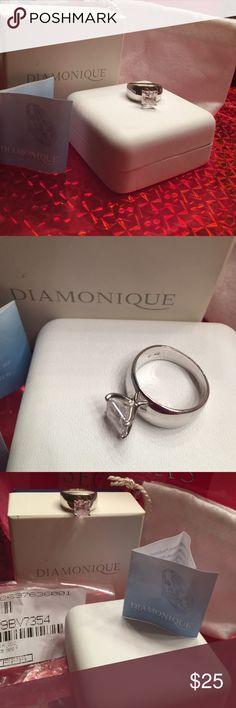 Diamonique sterling silver clad 2.5 karat QVC Diamonique Sterling Silver 2.5 ct princess wide band size 7. With original packaging. Diamonique QVC Jewelry Rings