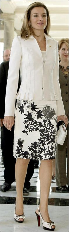 Letizia, Princess of Spain, in a black and white skirt ensemble.