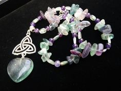 Check out this item in my Etsy shop https://www.etsy.com/listing/224073091/fluorite-triquerta-heart-necklace-of