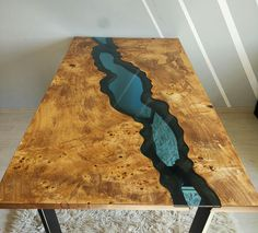 THIS TABLE IS SOLD! This river table made of old solid timber. In the middle blue transparent glass, knots filled with epoxy resin. Legs made of metal coated with mat black colour. Its unique, one of a kind solid piece of wood. The unique combination of tree rings to bring out the