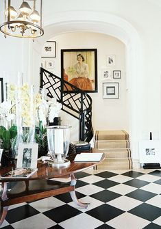 3 Common Stairway Design and Decor Mistakes {what to do instead} The elegant lobby and staircase of the JK Place Capri | I adore this Chinese Chippendale railing painted black. In fact I adore everything about this space! #chinesechippendale #jkplacecapri