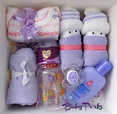 Onesie, diaper babies, washcloth, lotion, binkie, bottle