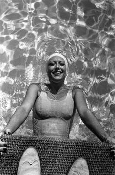 Joan Crawford photographed at her home pool, Brentwood, California. Early 1930s.