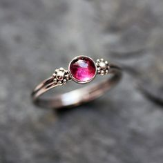 Pink rhodolite garnet ring - stacking ring - silver daisy - artisan metalsmith - ready to ship - size 6.5. $80.00, via Etsy.
