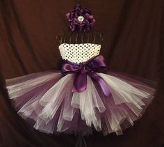 Baby Girl Tutu Dress Ivory and Plum with Flower by KarisaDavis, $35.00; etsy.com (newborn; Size: 0-3 months).