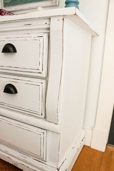 White Chalky Paint Dresser Makeover - The Happy Housie zinsser primer and Country Chic chalk based paint in white: it is called Simplicity with clear wax