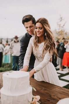"""That dress [   """"A lovely """"cutting the cake"""" picture"""",   """"These cake cutting songs will get you and your guests in the mood for layers of fondant and lots of love."""",   """"That dress and hair"""",   """"Very cute angle."""",   """"Awesome Plans & Tips For Your Wedding Day"""" ] #<br/> # #High #Neck #Dress,<br/> # #Dream #Wedding #Dresses,<br/> # #Wedding #Dressses,<br/> # #Simple #Cakes,<br/> # #Cake #Pictures,<br/> # #Dress #Picture,<br/> # #That #Dress,<br/> # #Weddingideas,<br/> # #Wedding #Venues<br/>"""