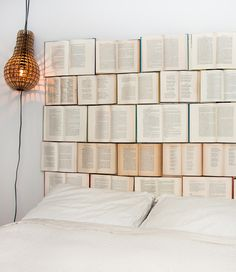 If you want to update the look of your bedroom, but don't want to spend a load of money on redecorating and brand new furniture, the DIY Book Headboard is a fun and inexpensive way to change things up. The DIY Book Headboard is a fun decoration project. Old Book Art, Old Books, Children's Books, Math Books, Music Books, Book Headboard, Headboard Ideas, Floating Headboard, Bookshelf Headboard