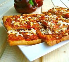 """Tomato and red pepper """"coca"""" (a type of pizza)"""
