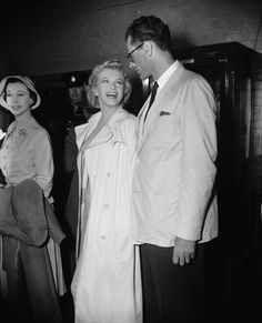 Marilyn Monroe with her husband, playwright Arthur Miller, and Vivien Leigh, on the Miller's arrival at Heathrow Airport, London, July 14th 1956.