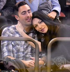 New romance? Laura Prepon cosied up with mystery man at the New York Rangers hockey game on Wednesday