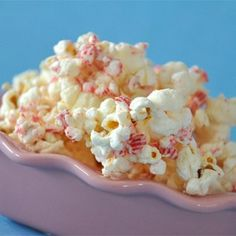 """Candy Cane Popcorn I """"A quick and easy holiday snack, made with vanilla almond bark and crushed candy canes. The kids love to help make this one!"""""""