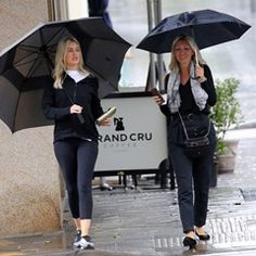 EXCLUSIVE Roxy Jacenko braves Sydney rain to have coffee with friend