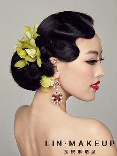 wave and bun resulting in a chic late 1910-1920's look