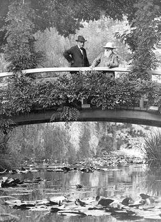 Claude Monet in his garden in Giverny with an unidentified visito