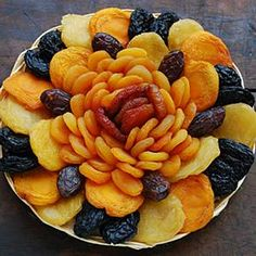 Dried Fruit Basket - F12C  This 12 inch round wicker basket has a beautiful arrangement of our famous dried fruit including Angelino plums, Medjool dates, Turkish apricots, peaches, pears, prunes and nectarines.    $35.95