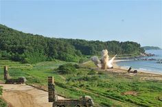 An M270 Multiple Launch Rocket System fires a U.S. Army tactical missile into the East Sea on Wednesday. U.S. Militar
