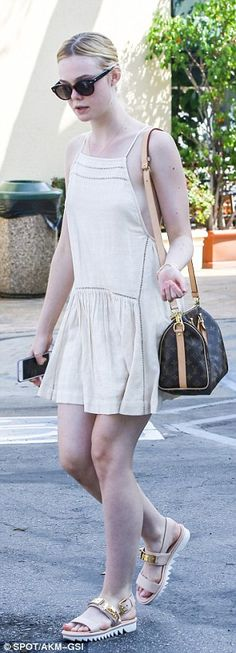 Girlish look: Wearing an off-white sundress, the 17-year-old actress looked particularly y...