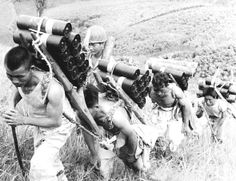 August 1950, Civilian workers carrying bombs to the ridge. They were major victims of the Korean war