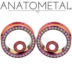 Halo Eyelets in ASTM F-136 titanium, anodized fuchsia with synthetic Opals #8 and #7 gems