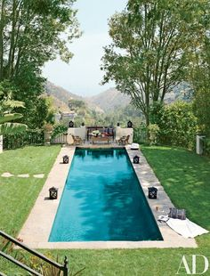 The lap pool at Ryan Seacrest's Mediterranean villa in California, designed by Jeff Andrews | archdigest.com
