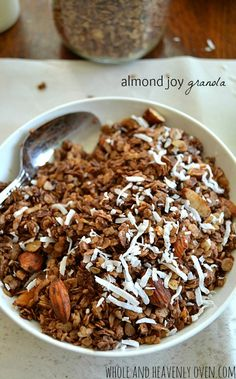 Chock-full of almonds, coconut, and chocolate; this almond joy-themed granola is a healthier breakfast alternative to the classic candy! #granola #almondjoy