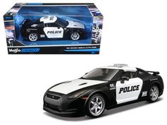 2009 Nissan GT-R (R35 ) Police Car Black and White 1/24 Diecast Model Car by Maisto - Brand new 1:24 scale diecast model car of 2009 Nissan GT-R (R35 ) Police Car Black and White die cast car model by Maisto. Brand new box. Rubber tires. Made of diecast with some plastic parts. Detailed interior, exterior. Has opening hood, doors and trunk. Dimensions approximately L-7.5, W-3.5, H-2.75 inches. Please note that manufacturer may change packing box at any time. Product will stay exactly the…