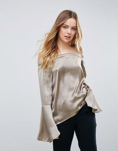 Buy it now. Neon Rose Satin Bardot Fluted Sleeve Top - Silver. Top by Neon Rose, Lightweight smooth satin, Bardot neck, Off-shoulder design, Elasticated shoulders, Fluted sleeves, Regular fit - true to size, Machine wash, 100% Polyester, Our model wears a UK S/EU S/US XS and is 173cm/5'8 tall. ABOUT NEON ROSE Neon Rose switches up its contemporary style from dusk till dawn, layering cool outerwear over relaxed playsuits, plunging necklines and midi dresses. Shop its separates for clean lines…