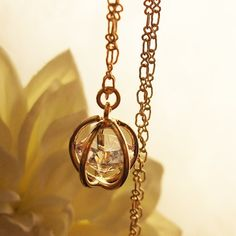 trapped in love gold and crystal necklace by theMIX on Etsy