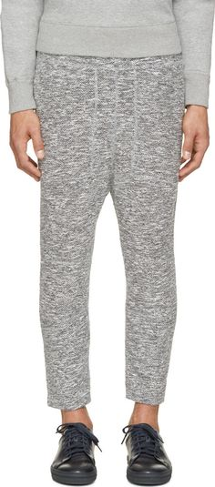 Cropped marled knit pants in pale and dark tones of grey. Drawstring-adjustable elasticized waistband. Three-pocket styling. Relaxed fit. Tonal stitching.