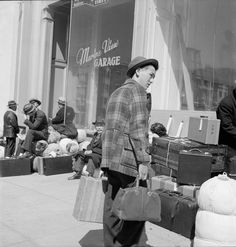 A young man arrived at 2020 Van Ness Avenue, the meeting place of the first contingent to be moved from San Francisco to the Santa Anita assembly center in Arcadia, Calif, 6 April 1942 (US National Archives: Dorothea Lange)