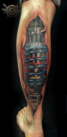 strut and shock tattoo... I would never get it but i enjoy the concept