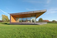 """Residential Architecture: Farm House in Obstgarten by k_m architektur: """"..a residence within a farmstead in langenargen, germany.encompassed by an orchard, the one-storey structure is lifted off the ground, appearing to float above the lawn and overlook theperpendicular rows of agricultural plantings. spanning the linear footprint, the continuous flat roof wraps the north half of the dwellingand bends into the ground plane, opening the elongated and glass-enclosed south elevation to the…"""